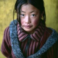Girl in a Chinese coat, Xigaze, Tibet, 2001